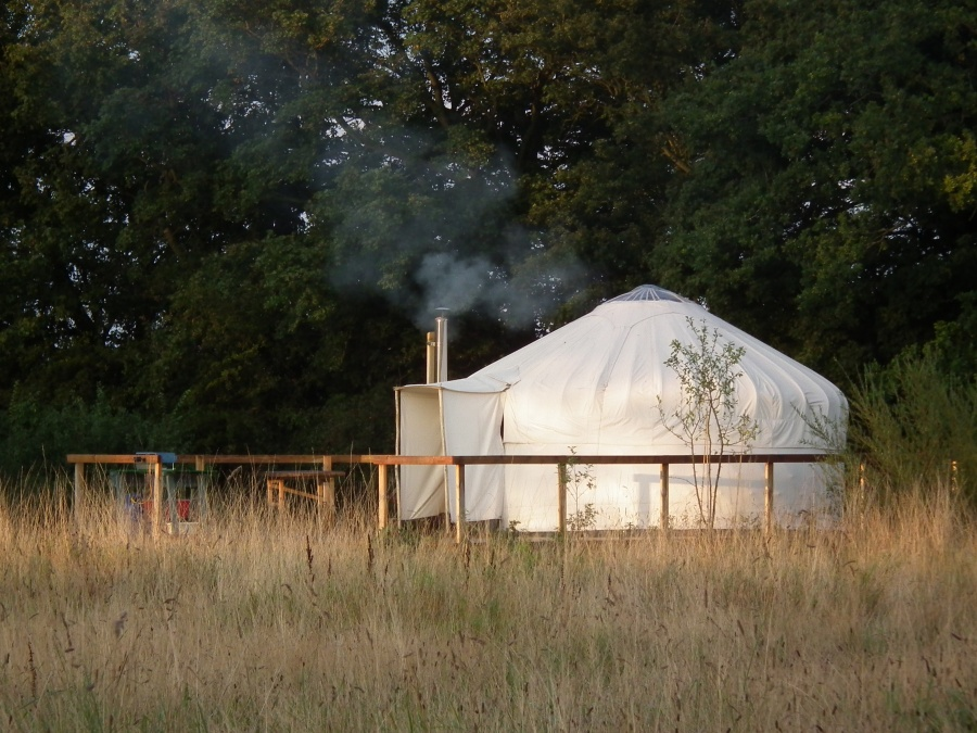 Swallow yurt with the fire going